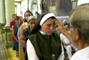 Nun receives blessing in church on Ash Wednesday